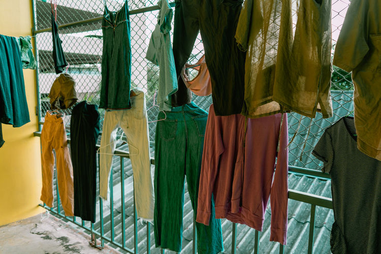 Rear view of clothes hanging at market stall