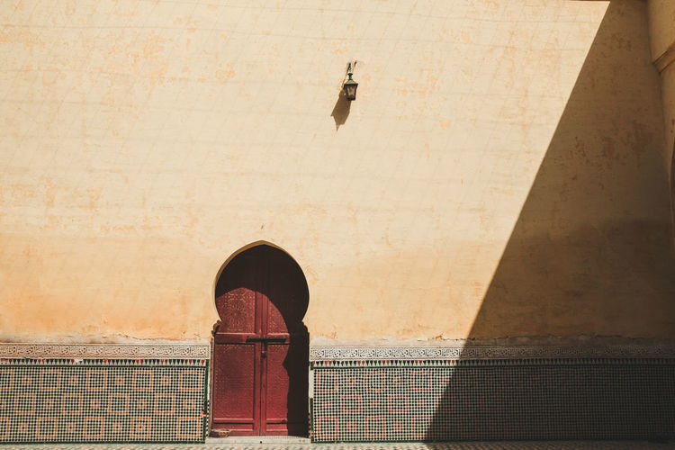 Meknès City Morocco Antique Ancient Door Arch Vault Vaulting Old Yellow Wall Muslim Islamic Architecture Art Built Structure Building Exterior Shadow Travel Destinations Shade Minimalism Minimal Closed Traditional Journey Slanting Shadows No People Day Wall - Building Feature Sunlight History Outdoors 17.62°