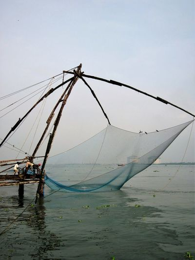 Beauty In Nature Chinese Fishing Net Day Fishing Fishing Net Kochi, India Nature No People Outdoors Sea Seascape Sky Water