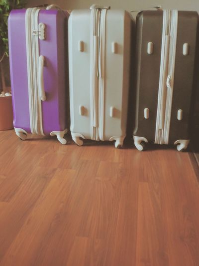 set of luggages in purple, grey, and black. Indoors  Variation No People Warm Warm Light Refreshment Escape Escape The City Purple Brown Luggage Travel Traveller Explore Close-up Wood Wood Floor Warm Colors Escape From Reality