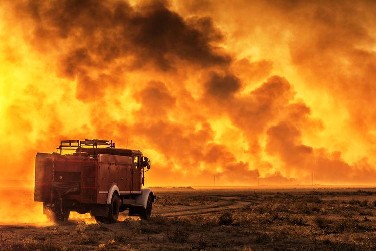 Blaze FiremansArm Smoke Field Fire Firemans Firemansam Landscape Nature No People Outdoors Sunset