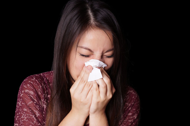 Asian  Tissue Vietnamese Woman Allergy Blowing Nose Close-up Cold Eyes Closed  Flu Girl Illness One Person People Sneezing Studio Shot Wiping Nose Women Young Adult Young Women