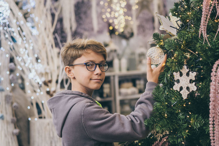Portrait of boy with christmas tree