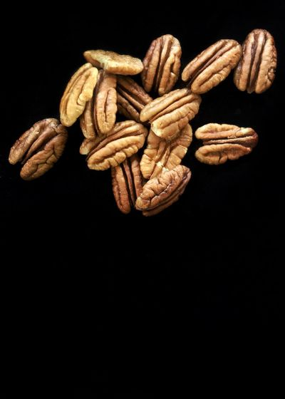 Pecan halves. Black Background Studio Shot Still Life Food Large Group Of Objects Healthy Eating Close-up Nuts Tree Crop Tree Nuts Pecan Pecans Vertical Copy Space