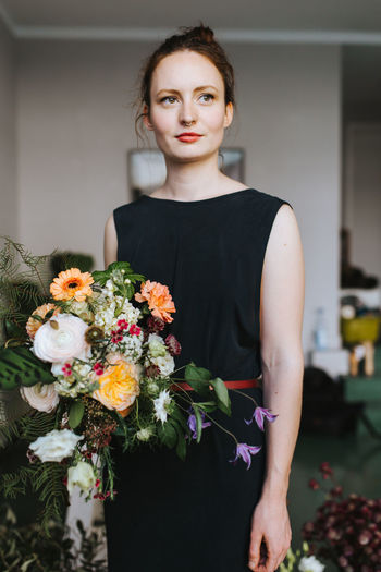 young female caucasian florist posing with a bouquet of flowers Business Decor Entrepreneur Flower Arrangement Plant Woman Arrangement Bouquet Business Woman Caucasian Colorful Connection Decoration Female Flora Floral Florist Flower Shop Flowers One Person Owner person Real People Shop Smiling