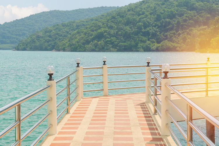 Water Railing Beauty In Nature Scenics - Nature Nature Tranquility Sea Staircase Tranquil Scene Day No People Sky Idyllic Architecture Tree Mountain Steps And Staircases Plant Sunlight Outdoors Balustrade