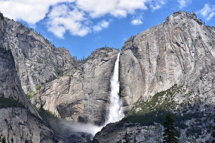 Scenics Nature Sky Waterfall Mountain Low Angle View Rock Formation Beauty In Nature Tranquil Scene Rock - Object Tranquility No People Outdoors Day Motion Cloud - Sky Travel Destinations Tree Mountain Range Water Yosemite National Park Yosemite Falls