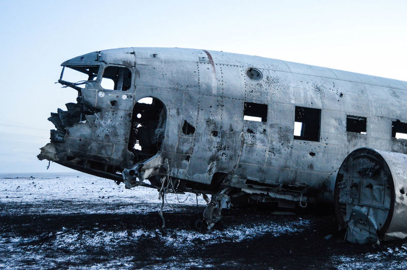 Abandoned Airplane At Beach Against Sky During Winter