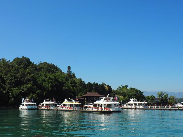 Ferry Boats Lake Water Tree Nautical Vessel Plant Sky Waterfront Mode Of Transportation Clear Sky Nature Blue Beauty In Nature Day