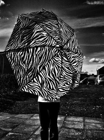 Umbrella zebra!😊 Umbrella Pattern Person Object Weather Girl Sky Monochromatic Monochrome Black And White Zebra Pattern Clouds Telling Stories Differently