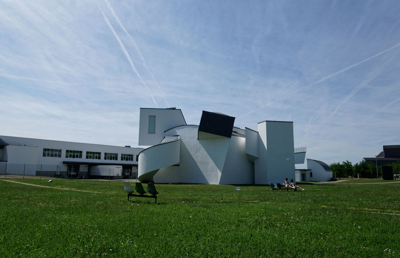 Architecture Vitra Design Museum Architecture Building Building Exterior Built Structure Cloud - Sky Day Environment Field Grass Green Color Industry Land Modern Nature No People Outdoors Sky Sunlight Transportation Vapor Trail Vitra Campus The Architect - 2018 EyeEm Awards
