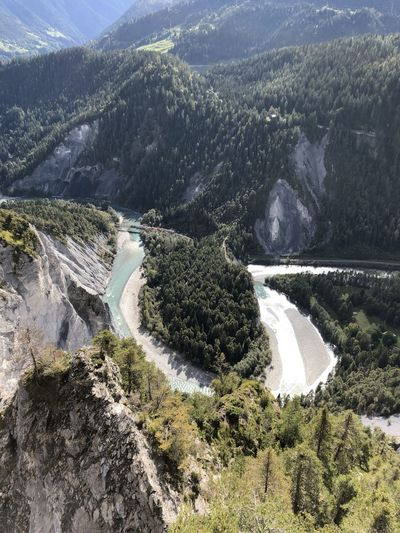 High angle view of river amidst mountains