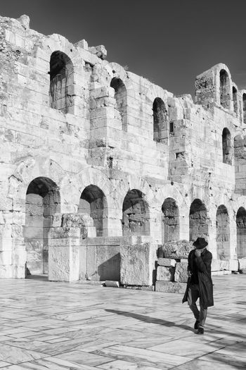 The Mysterious Man Architecture Archs Be. Ready. Black & White EyeEm Best Shots - Black + White Faceless Historical Sights Man Man With Hat Travel Arch Black And White Bw Greece Greek Architecture Man With A Hat Travel Destinations Walking Black And White Friday Fashion Stories Shades Of Winter An Eye For Travel This Is Masculinity Stories From The City