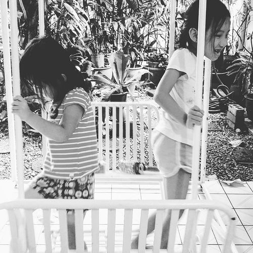 Girls Having Fun Kids Having Fun Swing Bnwsingapore Bnw_life Bnw_collection Bnwphotography Bnw_society Streetphotography Singapore CNY Chinese New Year 2017 CNY2017 Singapore