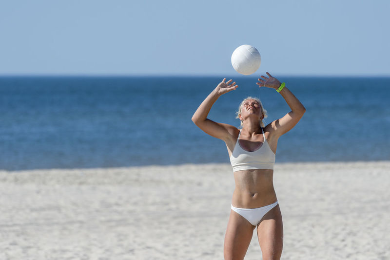 Full length of woman standing at beach