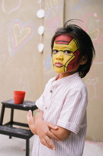 Boy with Ironman facepainting Art Birthday Birthday Party Birthdayboy Boy Casual Clothing Close-up Facepainting Focus On Foreground Headshot Holding Ice Cream Indulgence Leisure Activity Lifestyles Portrait Superhero Superheroes