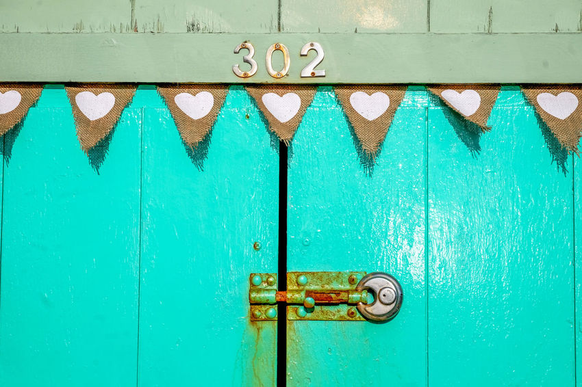 Brighton Beach Locked Backgrounds Blue Brighton Beach Huts, Bunting Flags Buntingflag Close-up Closed Day Door Doorway Full Frame Green Color Heart Shape Heart Shaped Bunting Metal No People Numbers Numbers And Signs Outdoors Protection Rusty, Door Safety Wood - Material