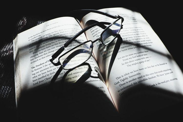 High angle view of eyeglasses on book