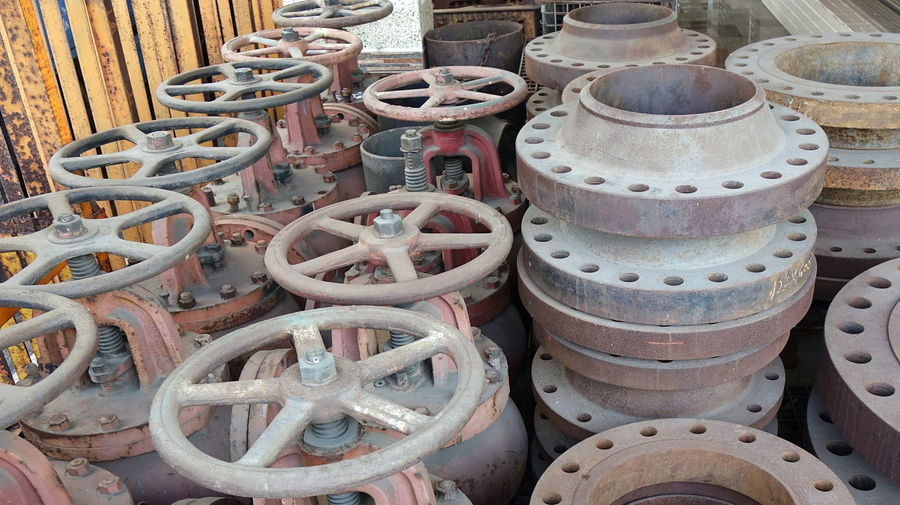 Large ship valves with hand wheels to be used in shipbuilding Corrosion Maritime Bolts And Nuts Equipment Handwheel Industrial Tool Industrial Valve Machine Part Metal Rusty Shipbuilding Steel Valves