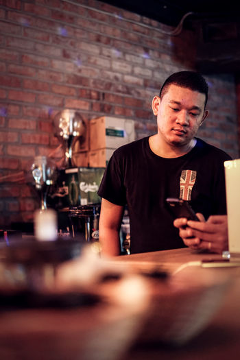 Male Bartender Working In Bar