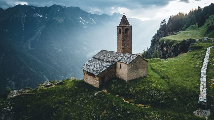 Church in Switzerland Church Switzerland Built Structure Architecture Building Exterior Building Tower Plant Sky Nature Tree Place Of Worship Religion Travel Destinations Cloud - Sky Travel Spirituality Day No People Belief Outdoors Clock