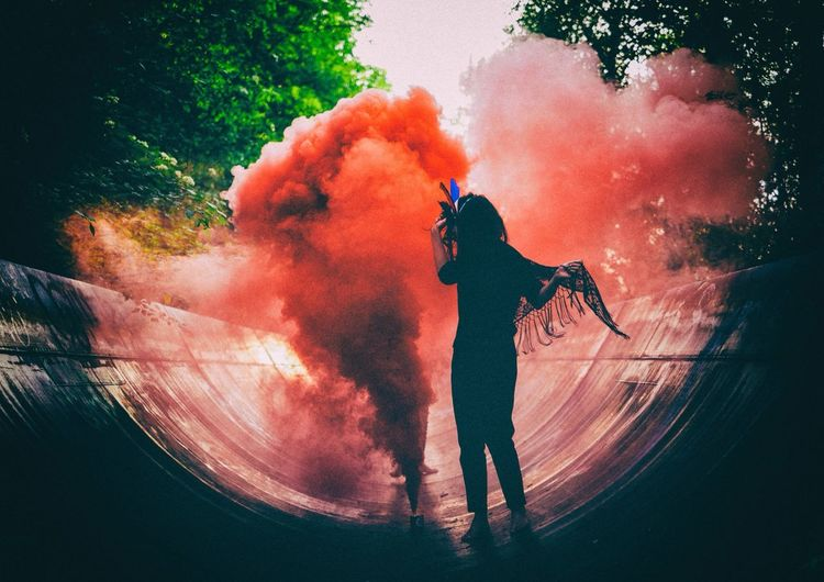 Woman standing near smoke bomb