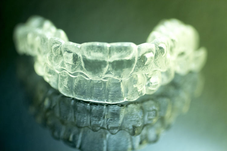Close-up of plastic dentures on glass table
