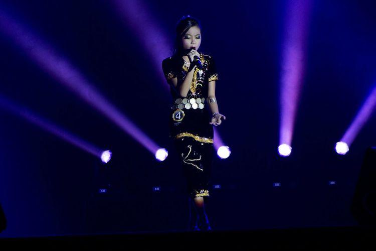 Girl In Costume Singing On Stage During Sabah Harvest Festival