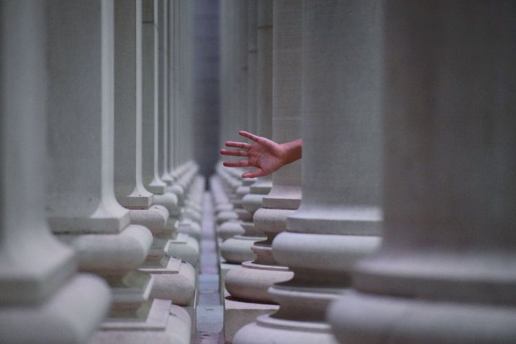 Selective Focus Focus On Foreground Red Person Human Finger Large Group Of Objects Architecture Photography Architecture Pillars Hand First Eyeem Photo