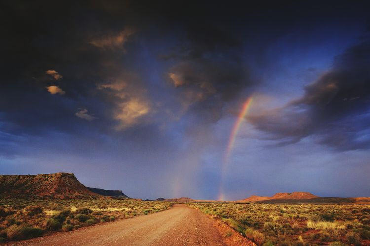 Utah rainbow Scenics Landscape Nature Beauty In Nature Winding Road Mountain Outdoors Sky Weather Road Dirt Road Rainbow Rainbow Sky Storm Storm Cloud No People Rainbows Utah Utahisawesome National Geographic Natgeolandscape Landscapes Betterlandscapes Travel