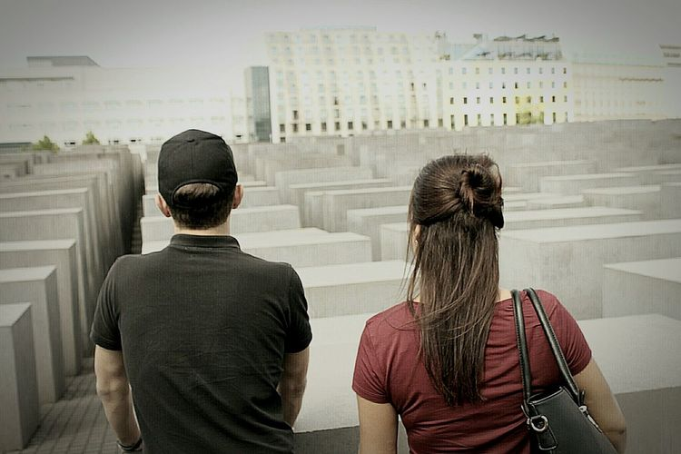 Berlin. Holocaust Memorial Rear View Togetherness Cityscape Outdoors Adults Only Awe Day City Men And Women Talking Pictures Past Young Adult Sightseeing Travel Photography I Want A Better World Now ! Berlin Berlin Photography God Bless You All Memorial