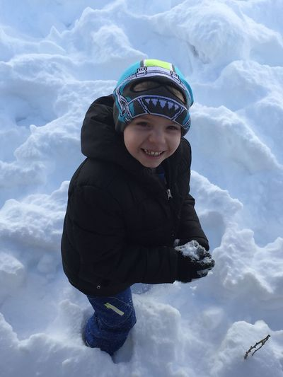 Portrait of a boy playing in snow