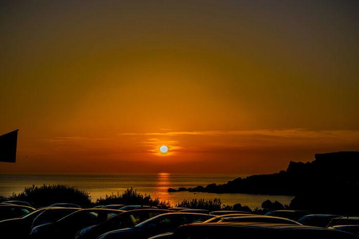 Golden Bay, Malta Malta Mediterranean Sea Orange Sky Beauty In Nature Car Dramatic Sky Golden Bay Horizon Over Water Island Nature No People Outdoors Scenics Sea Silhouette Sky Sun Sunset Tranquil Scene Tranquility Travel Destinations Wallpaper Water