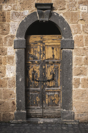Arch Architecture Built Structure Building Exterior Old Entrance The Past History Door Day No People Closed Wall Building Brick Safety Security Protection Wall - Building Feature Outdoors Stone Wall Ancient Civilization Italy Italia Italian Food Doorway Doors Door Knocker Abandoned Town Medieval Tuscany Vintage Vintage Style Vintage Shopping Wall Texture Pattern Wood - Material Wood Stone Stone Material Stone - Object Stones Chain Door Handle Background Photography Architecture Architecture_collection Architectural Detail
