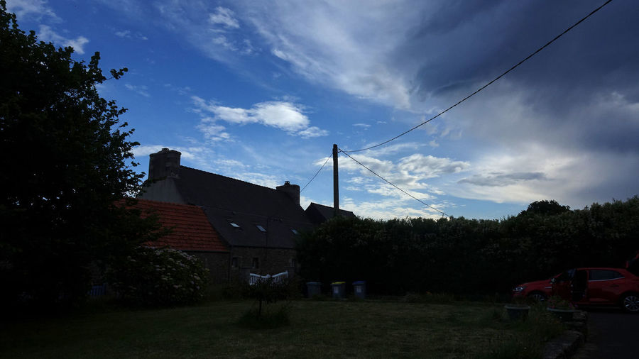 Bretagne Holiday Upcoming Storm It Is Getting Dark Sky Cloud - Sky Architecture Built Structure Tree Plant Building Exterior Building Nature No People House Cable Field Outdoors Land Power Line  Day Transportation Electricity