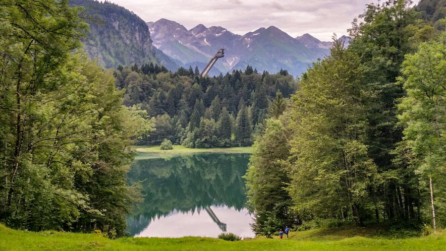 Oberstdorf & Umgebung Germany Skyjump Tree Mountain Forest Lake Water Sky Mountain Range Landscape