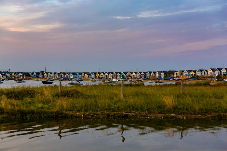 Sunset by the beach huts Hengistbury Head Peaceful Vacation Natural Barrier Christchurch Mudeford Dorset Uk Boats EyeEm Gallery EyeEm Selects Beach Huts Seaside Seascape Colourful Holidays Water Reflection Sky Landscape Tide