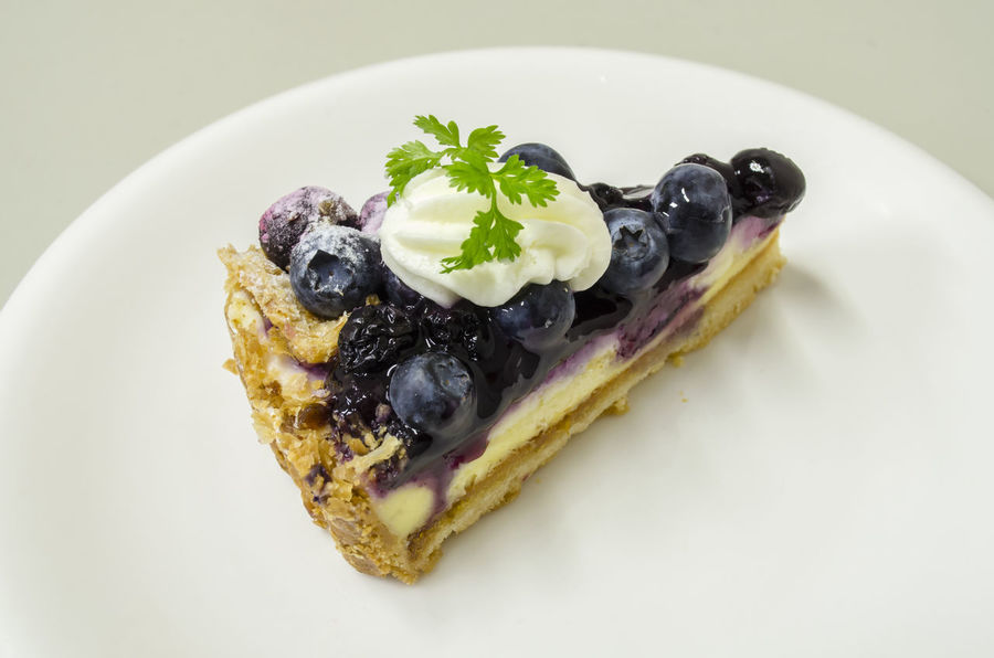 Delicious Blueberry Cheese Pie Blueberries Blueberry Blueberry Pie Blueberrycheesecake Cake Close-up Cream Dessert Food Food And Drink Food Styling Freshness Fruit Garnish Gourmet Indoors  Indulgence Mint Leaf - Culinary No People Plate Ready-to-eat Serving Size Studio Shot Sweet Food Temptation Unhealthy Eating White Background