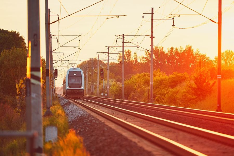 Traveling by modern passenger train. Railway at the beautiful sunset (golden hour). Commuting Connection Electricity  Electricity Pylon Golden Hour Landscape Mode Of Transport Modern Nature Passenger Train Power Line  Public Transportation Rail Transportation Railroad Track Railroad Track Railway Straight Sunlight Sunrise_sunsets_aroundworld Sunset Sunset_collection Sunshine Train Train - Vehicle Transportation