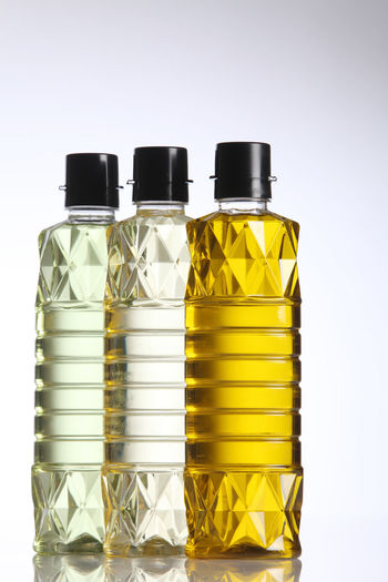 Close-Up Of Cooking Oil Against White Background