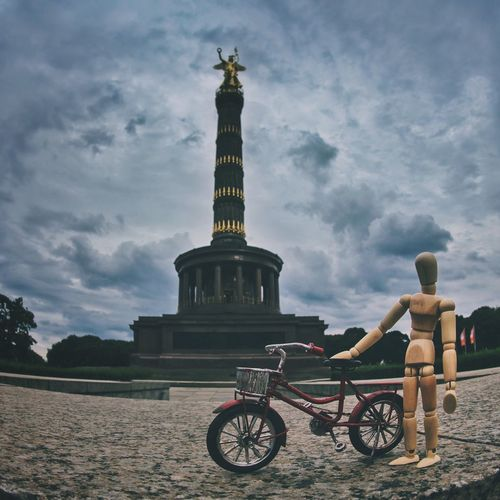 Biking around Berlin Cloud - Sky Sky Human Representation Statue Travel Destinations Outdoors Sculpture Day Architecture Travel Built Structure Building Exterior One Person Full Length Berlin Germany Woodyforest Bike Discover Berlin