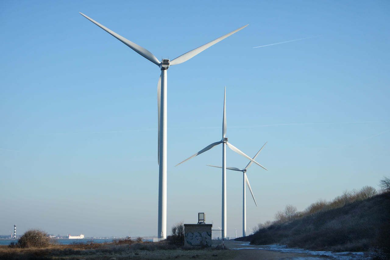 renewable energy, alternative energy, environmental conservation, wind turbine, fuel and power generation, wind power, turbine, environment, sky, nature, no people, clear sky, water, blue, day, technology, rural scene, landscape, outdoors, sustainable resources