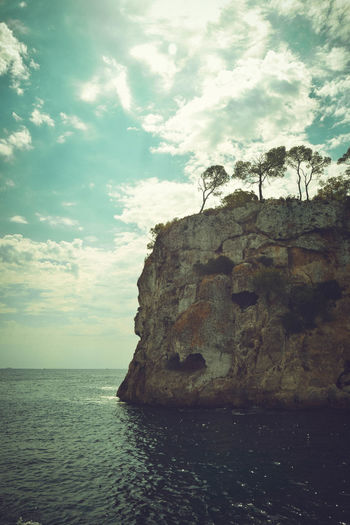 Rock Formation Scenic Beauty In Nature Cloud - Sky Day Horizon Over Water Landscape Nature No People Outdoors Picturesque Portrait Rock - Object Scenics Sea Sea Caves Sky Space For Copy Sunset Tranquil Scene Tranquility Trees On Rock Water