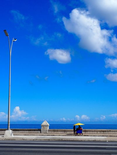 Sky Cloud - Sky Day Transportation Nature Road Blue Architecture Built Structure Men Street People Building Exterior Real People Outdoors Land Sitting Environment Industry
