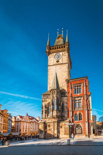 Architecture Astronomical Clock Bell Tower Blue Building Exterior Built Structure City Clear Sky Clock Clock Tower Day History No People Outdoors Place Of Worship Prague Religion Sky Spirituality Tower Travel Destinations