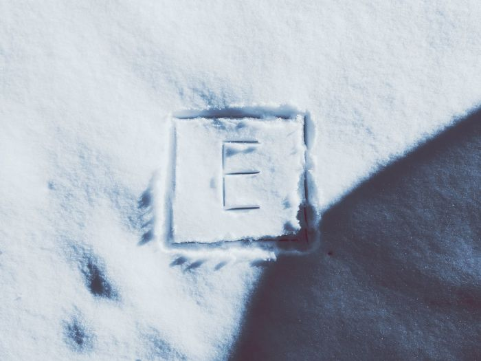 High angle view of text on snow