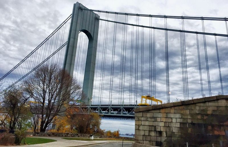 Bridge - Man Made Structure Connection Architecture Engineering Built Structure Transportation Suspension Bridge Travel Destinations Cloud - Sky Sky Travel Outdoors River Day Bridge Low Angle View City Tree Building Exterior No People Verrazano Bridge Walking Around City