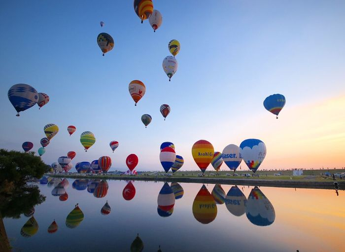 International balloon festival 2017 in Japan. Hot Air Balloon Flying Multi Colored Sky Nature Mid-air Low Angle View Large Group Of Objects Clear Sky No People Outdoors Tree Ballooning Festival Day Beauty In Nature dawn sunset