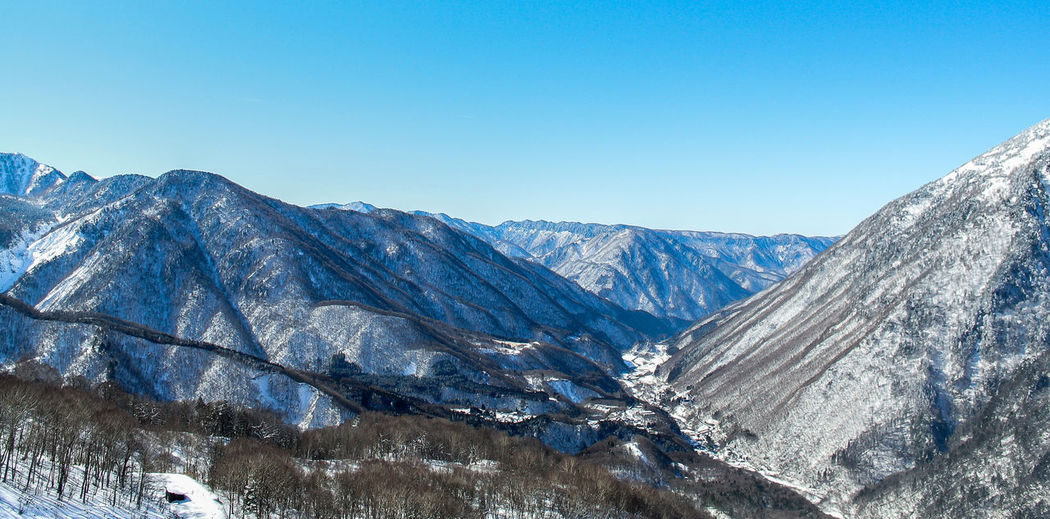 Snow at mountain with forest Background Beauty In Nature Blue Sky Christmas Cold Cold Temperature Cold Weather Cold Winter ❄⛄ Day Freshness Japan Landscape Mountain Mountain Range Nature Nice View Pine Tree Scenic Landscapes Scenics Snow Space Traveling Tree View Weather