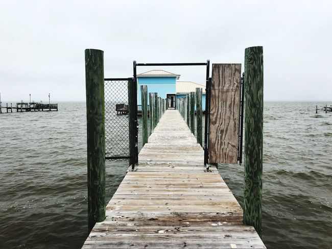 Water Sea Pier Beach Jetty Wood - Material Day Outdoors Horizon Over Water Tranquility Tranquil Scene Nature Built Structure Wooden Post No People Summer Scenics Sky